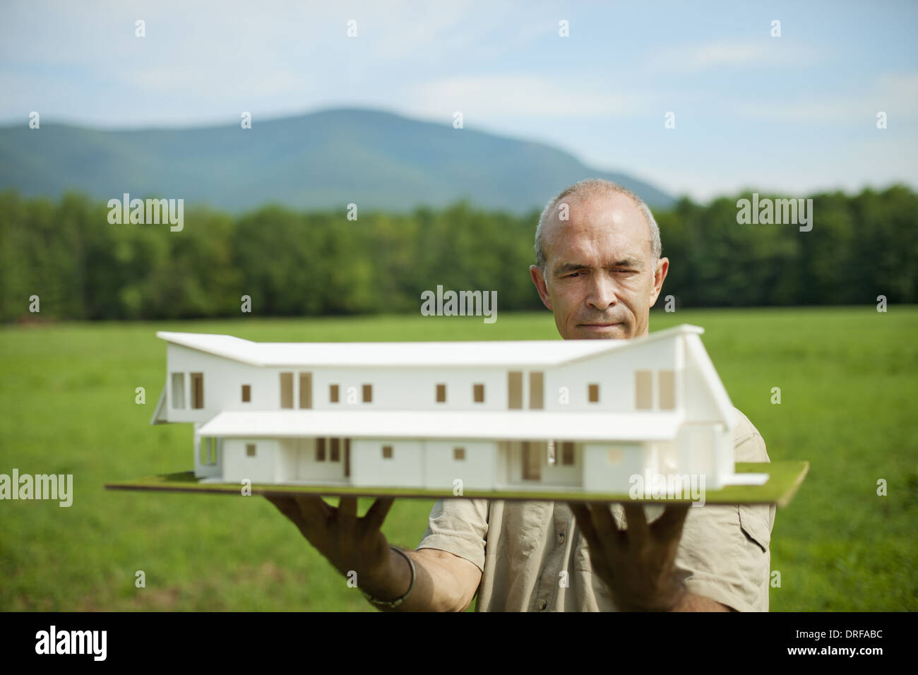 New York state USA person holding scale model new building - Stock Image