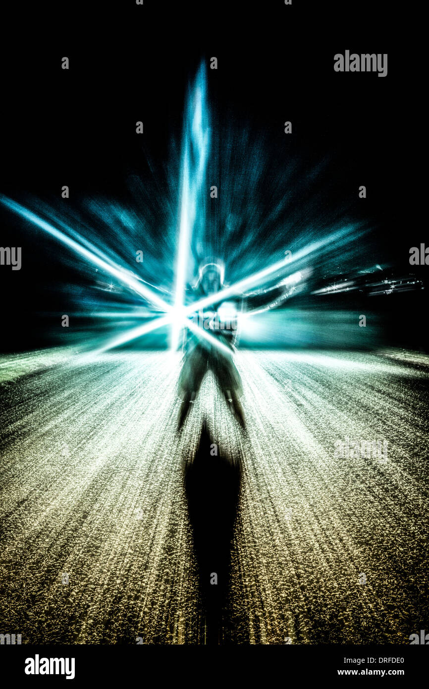 Abstract photo of a man and light effects over dark background - Stock Image