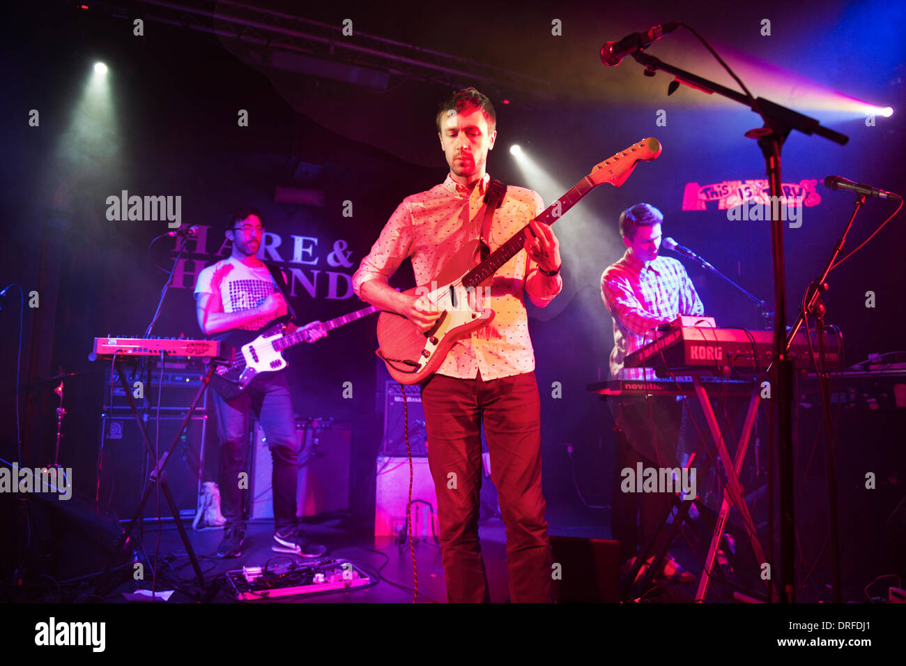 Birmingham, UK. 23rd January 2014. British rock band Teleman perform a gig at The Hare & Hounds, King's Heath, Birmingham. Lead singer and guitarist (front) Thomas Sanders. - Stock Image