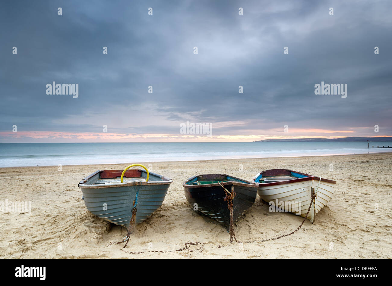 Boats at Durley chine on Bournemouth beach in Dorset - Stock Image