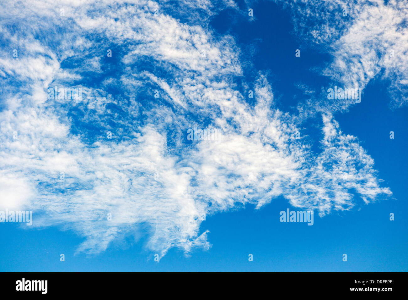 Wispy white clouds against an azure Colorado sky - Stock Image