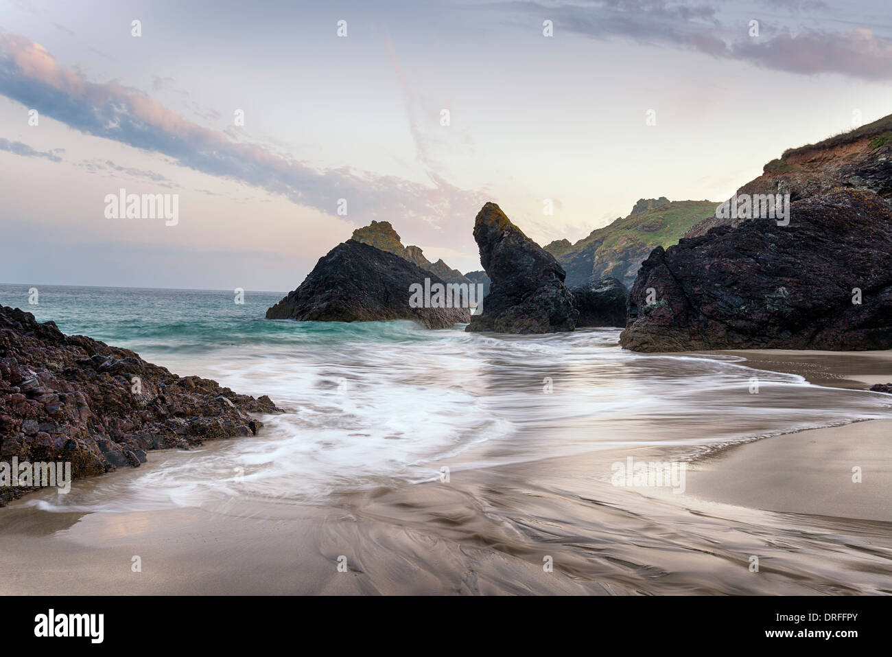 Dusk at Kynance Cove beach on the Lizard in Cornwall - Stock Image