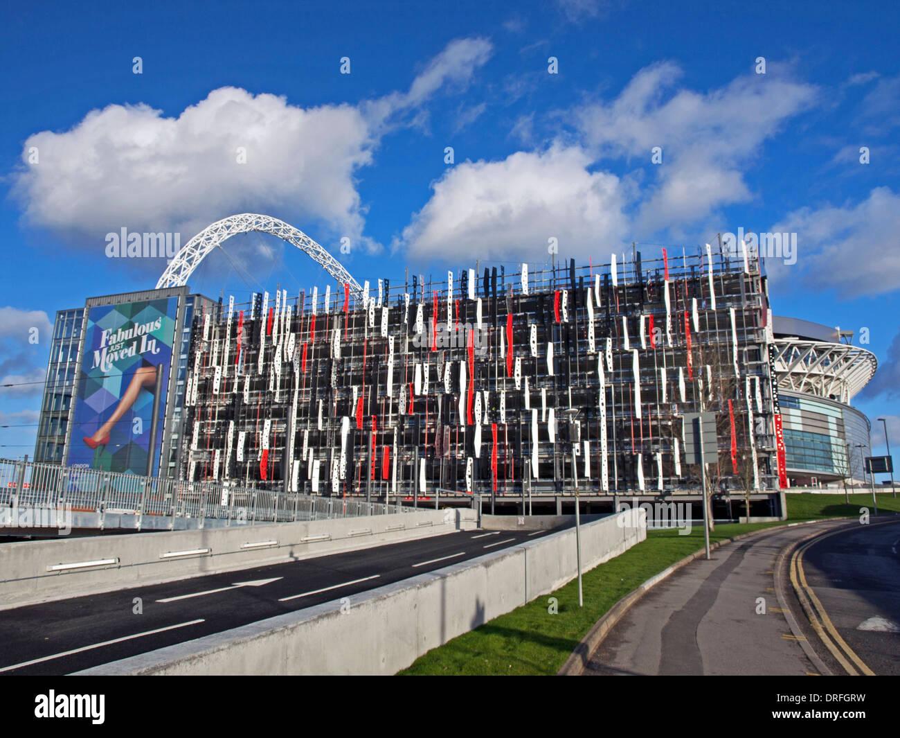 View of Wembley Stadium showing the London Designer Outlet car park, London Borough of Brent, London, England, UK - Stock Image