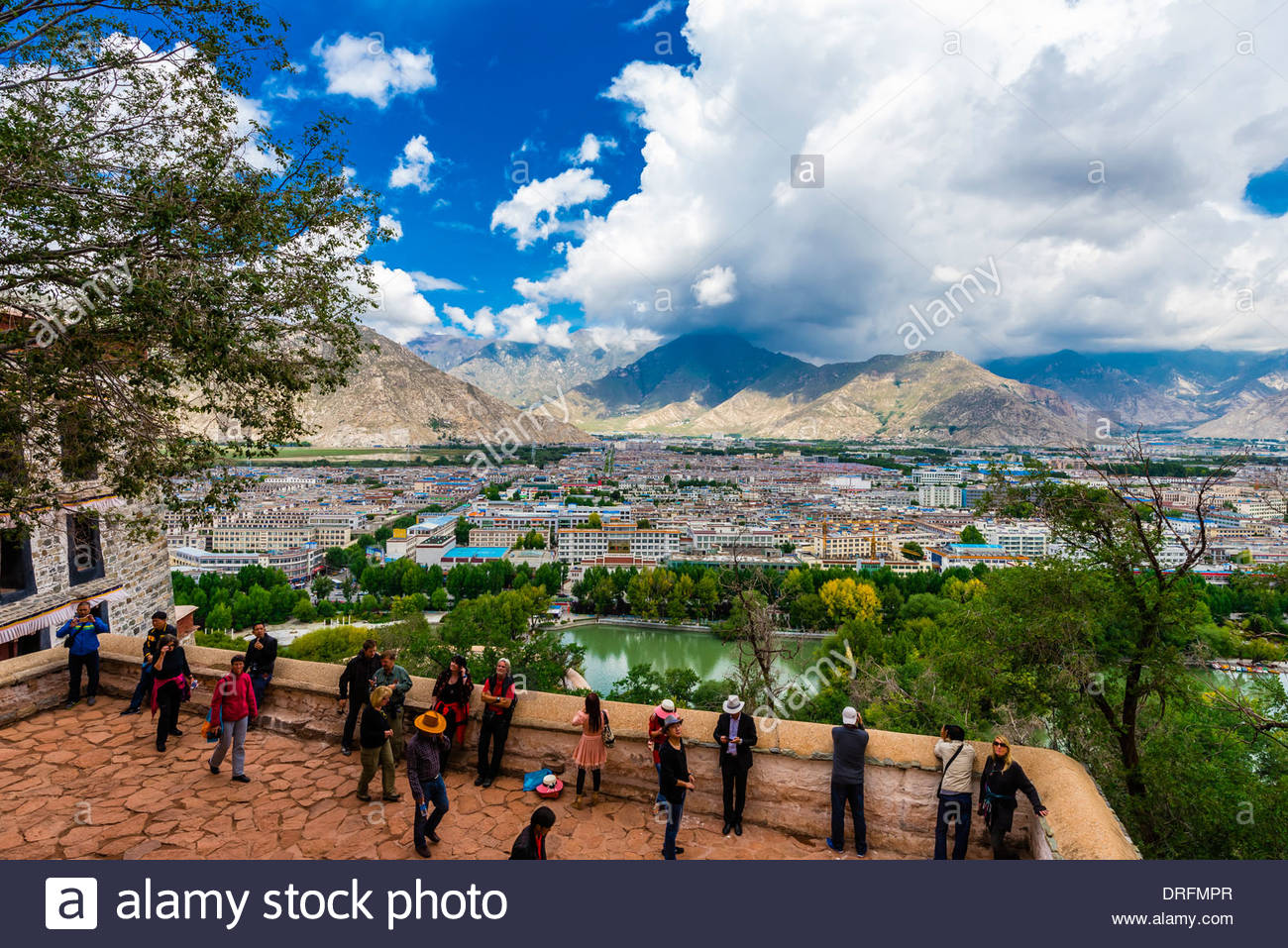 Overview of the Lhasa skyline from the Potala Palace (a UNESCO World Heritage Site) was the chief residence of the Dalai Lama until the 14th Dalai Lama fled to Dharamsala, India, during the 1959 Tibetan uprising. The massive palace contains 999 rooms. Lhasa, Tibet, China. - Stock Image