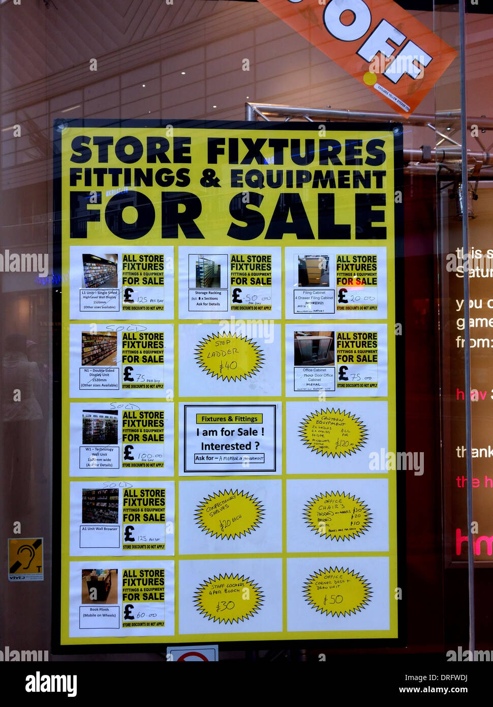 Store closing down sells off fixtures and fittings, London - Stock Image