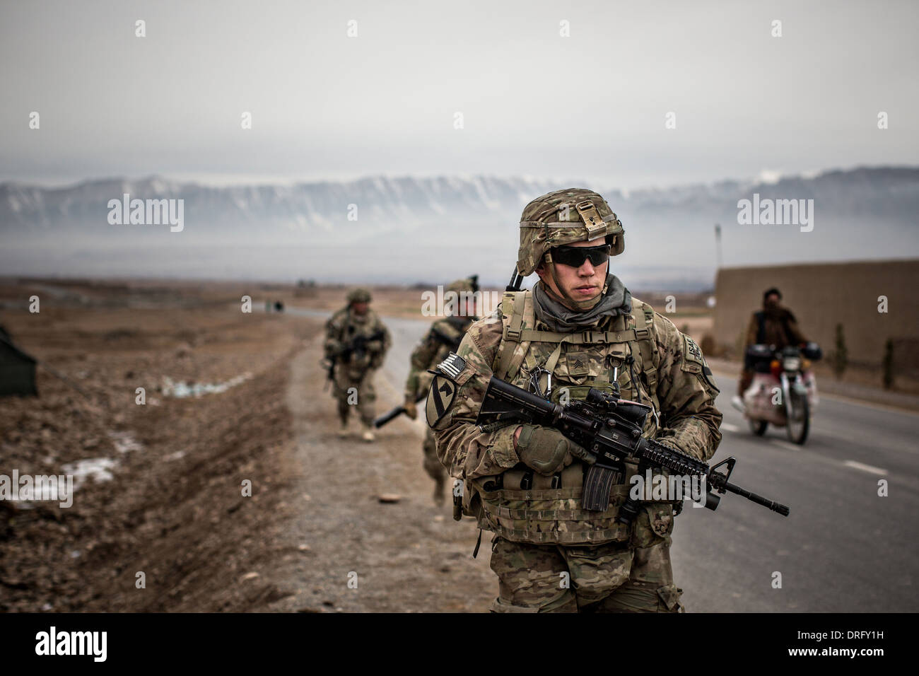 US Army soldiers with the 1st Cavalry Division conduct a a patrol January 12, 2014 in Tirin Kot, Uruzgan province, Stock Photo