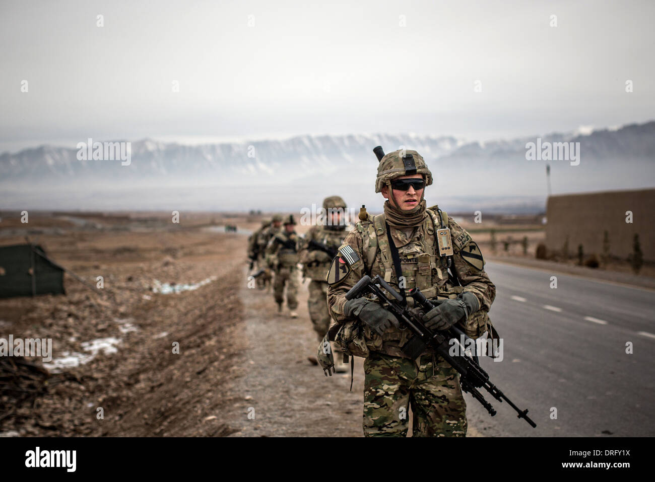 US Army soldiers with the 1st Cavalry Division conduct a patrol January 12, 2014 in Tirin Kot, Uruzgan province, Stock Photo