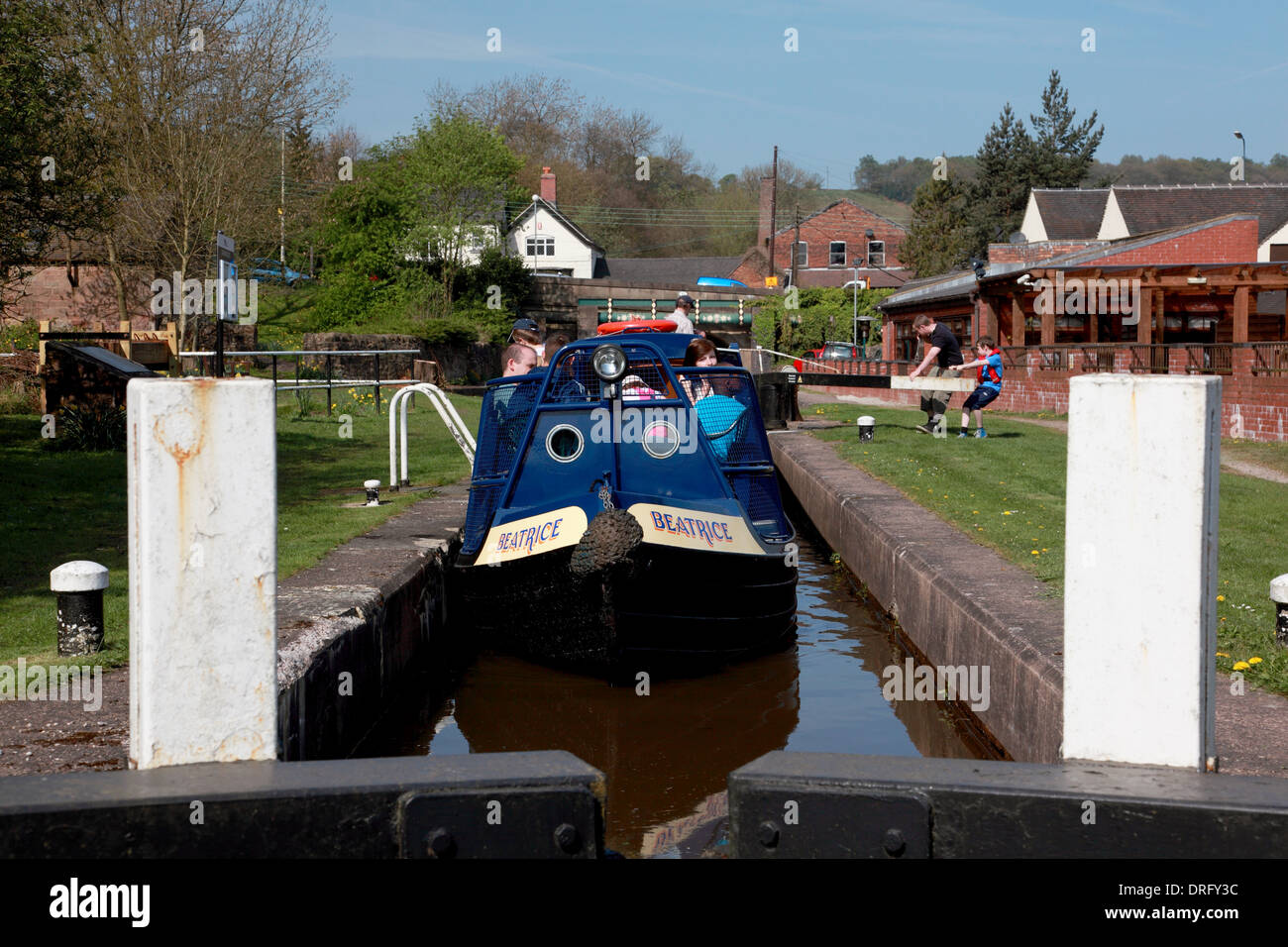 A narrowboat in lock 13 of the Cheddleton Locks on the Caldon Canal - Stock Image