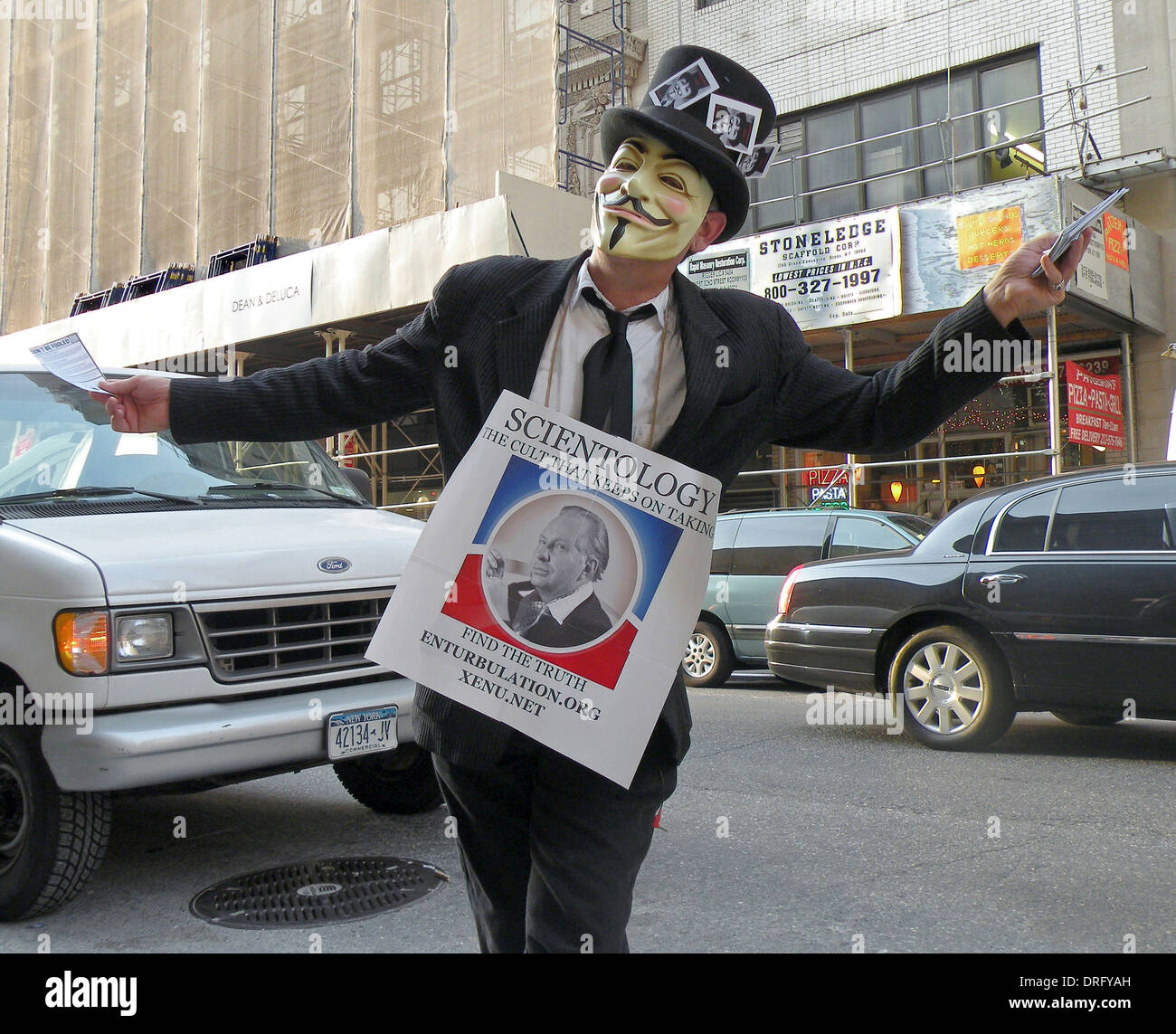 Portrait of a masked man in New York City's theater district protesting against Scientology - Stock Image