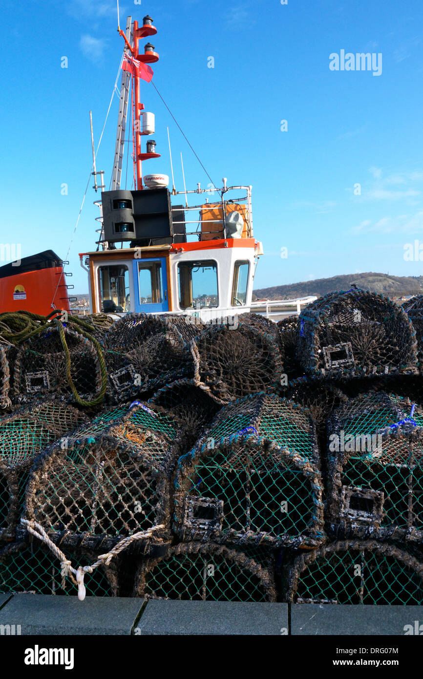 Lobster pots on the harbour side at Conwy, in North Wales. Stock Photo
