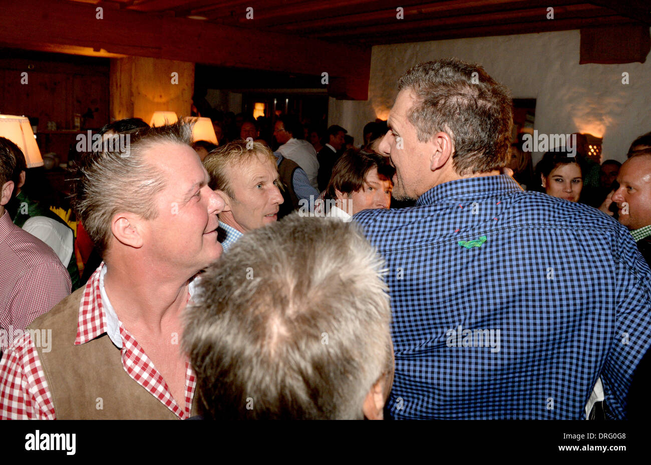 Kitzbuehel, Austria. 24th Jan, 2014. Actor Ralf Moeller (R) and Marcus Prinz von Anhalt are pictured at the Bavarian veal sausage party in the Stanglwirt bar near Kitzbuehel, Austria, 24 January 2014. Many celebrities came for the annual Austrian downhill ski race Hahnenkamm race in worldfamous skiing location. Photo: Felix Hoerhager/dpa/Alamy Live News - Stock Image