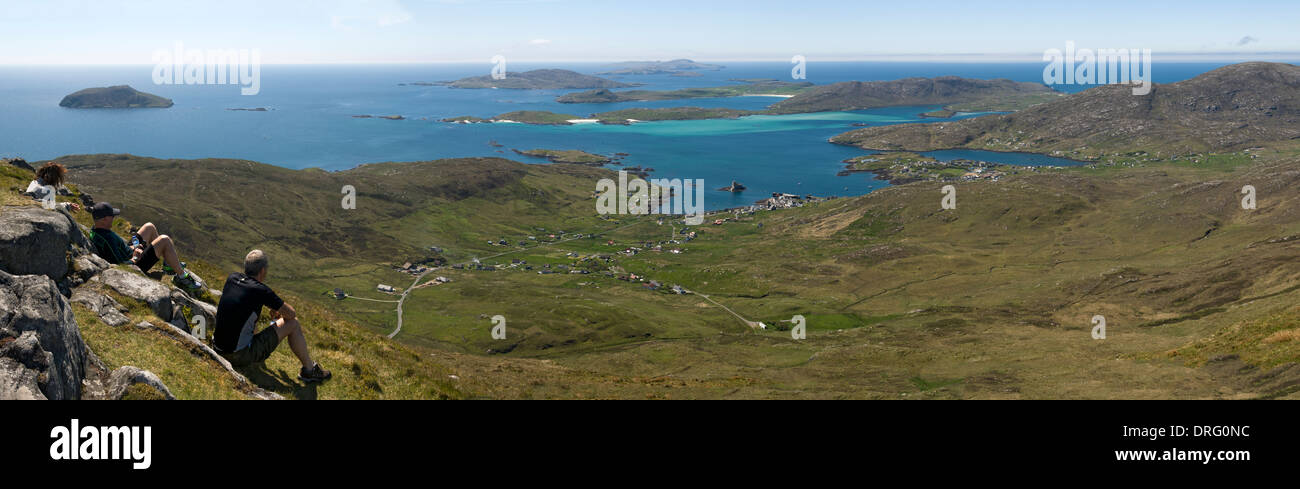 Walkers on the summit of Heabhal (Heaval) on the Isle of Barra, Outer Hebrides, Scotland, UK. Stock Photo