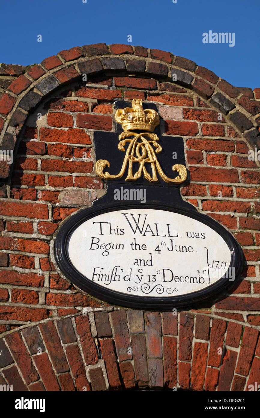 This wall was begun the 4th June and Finifh'd ye 13th Decembr 1711 plaque on wall at Portsmouth Historic Dockyard in January - Stock Image