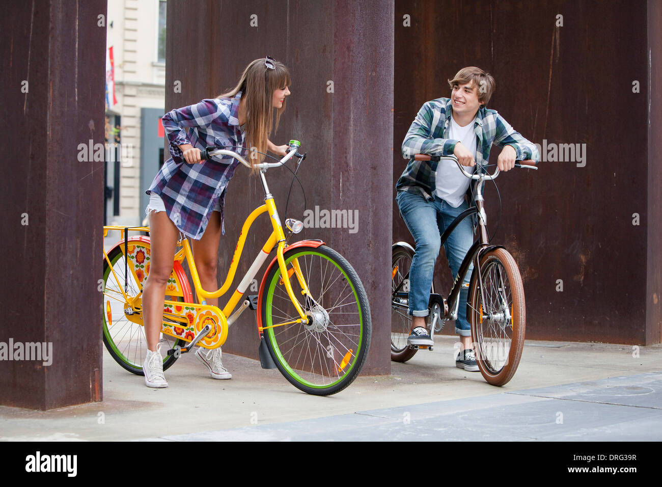 Young couple with bicycles, taking a rest, Osijek, Croatia - Stock Image