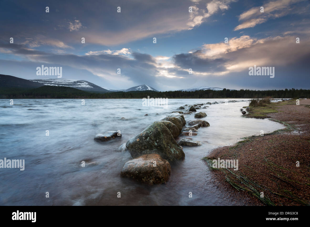 Dawn breaking over Loch Morlich in mid-winter. Stock Photo