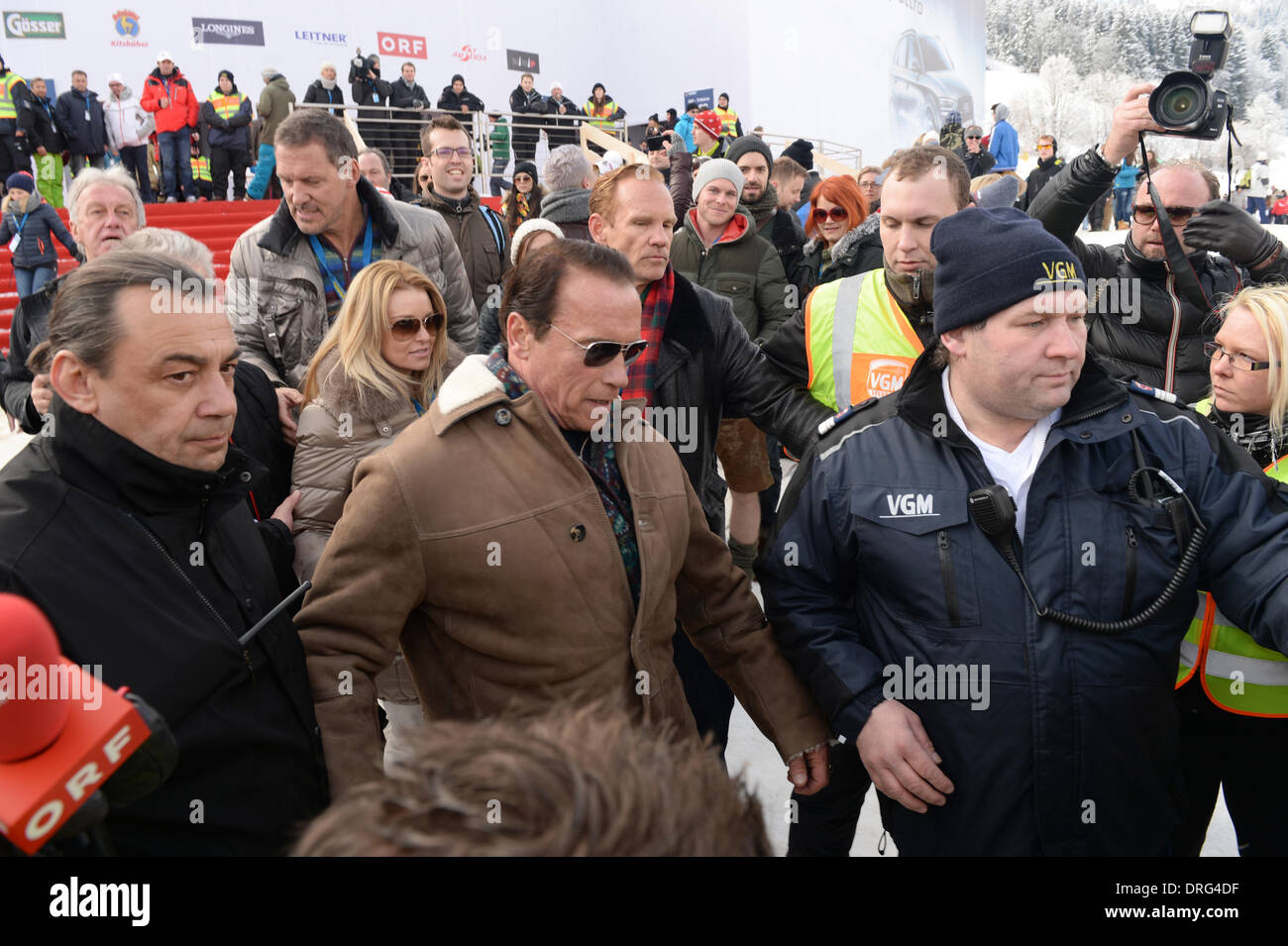 Kitzbuehel, Austria. 25th Jan, 2014. Former US governor and Hollywood actor Arnold Schwarzenegger (C) and his girlfriend Stock Photo