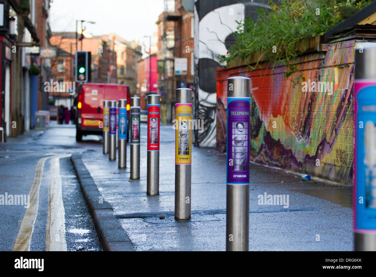 Telephone Stainless steel posts, pedestrian barriers and poster advertising in Stevenson Square, Northern Quarter, Stock Photo