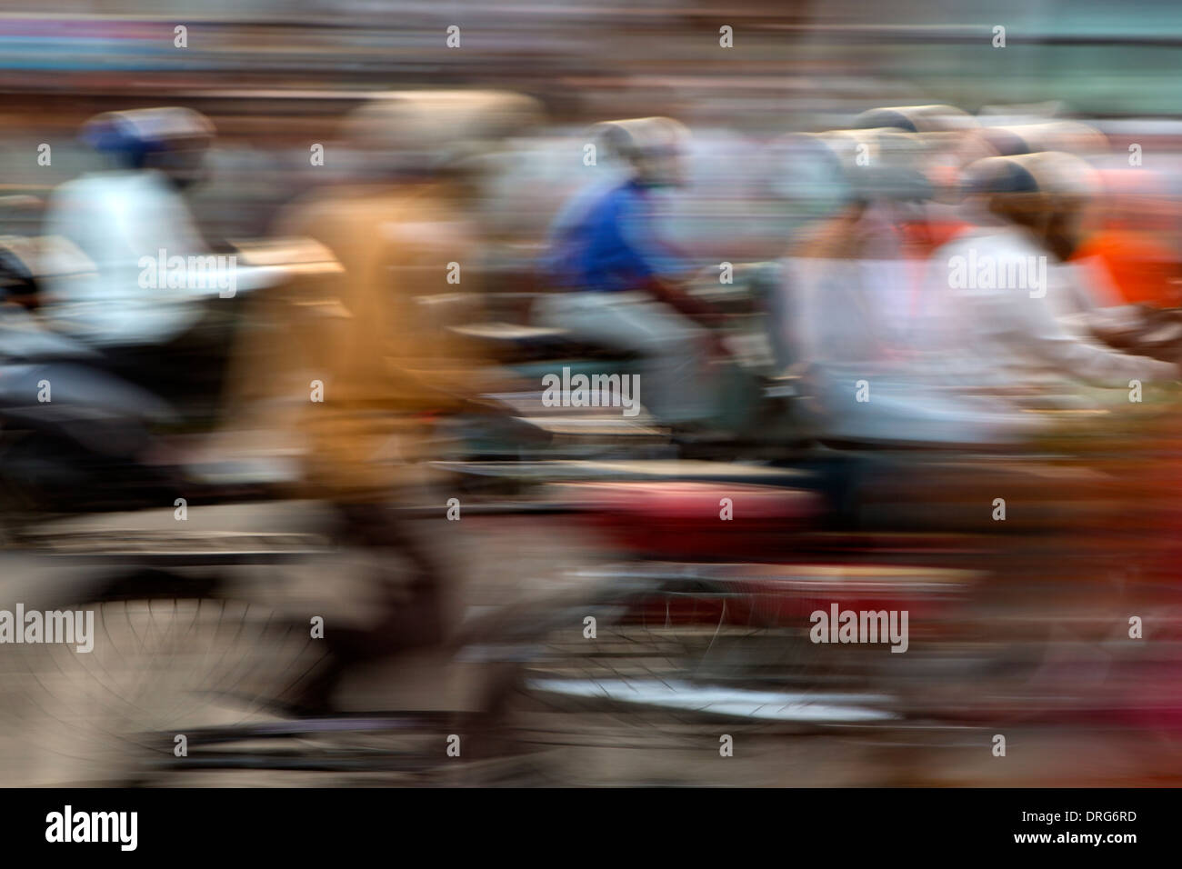 India, Rajasthan, Jaipur, Blur motion effect of commuters on bikes and motorbikes - Stock Image