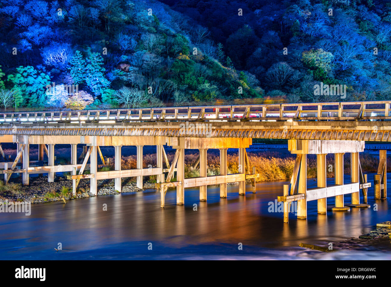 Arashiyama, Kyoto, Japan at Togetsukyo Bridge during the annual autumn light up. - Stock Image
