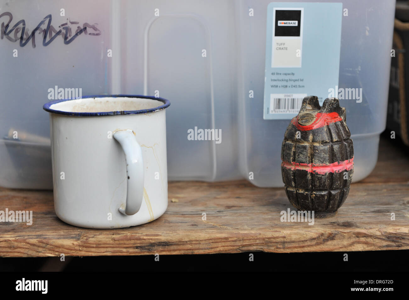 Charlwood, Surrey, UK. 25th January 2014. A Mills Hand Grenade and an enamel mug at the Trench. Credit:  Matthew Chattle/Alamy Live News - Stock Image