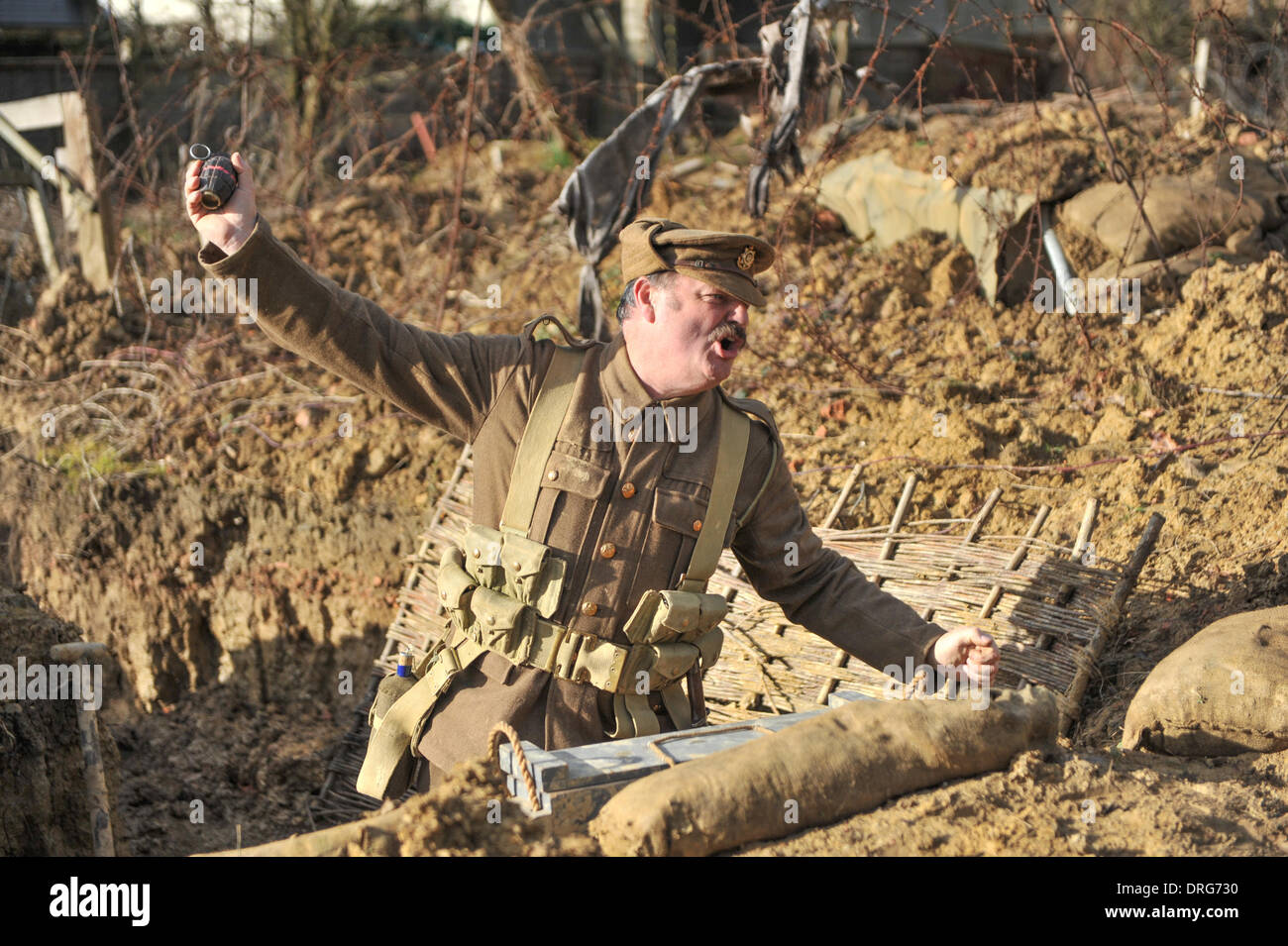 Charlwood, Surrey, UK. 25th January 2014. Throwing a Mills Hand Grenade at the Trench. Credit:  Matthew Chattle/Alamy Live News - Stock Image
