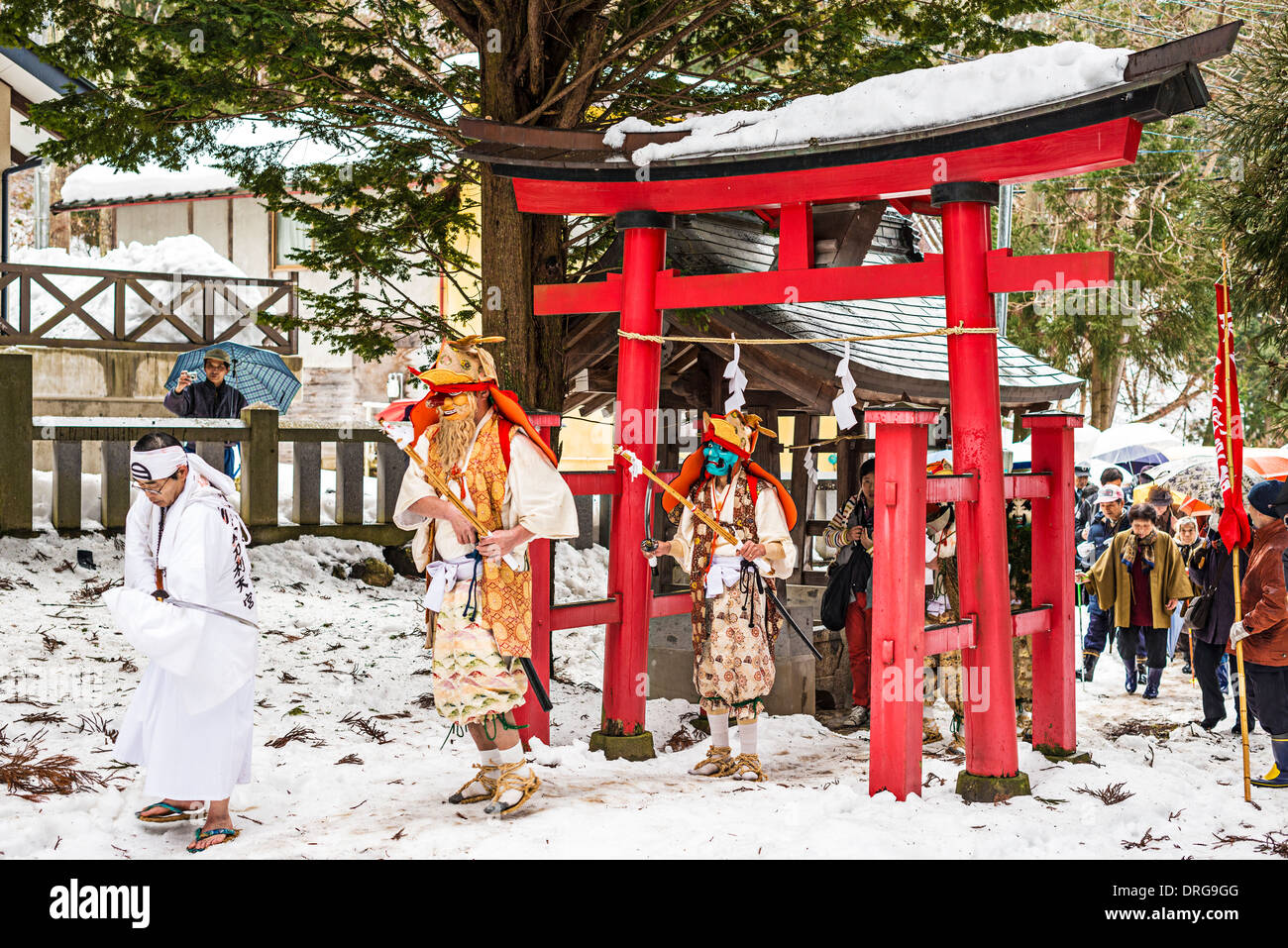 Shinto ascetics lead a procession in Nagano, Japan. - Stock Image
