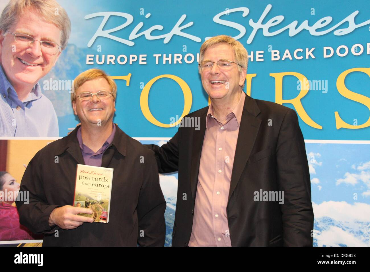 Santa Clara, California USA, 25 January, 2014 – PBS television travel show host Rick Steves meets his look-alike at the San Francisco Bay Area Travel and Adventure Show held at the Santa Clara Convention Center. Rick (right) has written over 50 travel guidebooks. His doppelganger Paul Richards (left) lives in San Jose, California and is often asked if he is Rick Steves, the travel expert. Credit: Lisa Werner/Alamy Live News - Stock Image