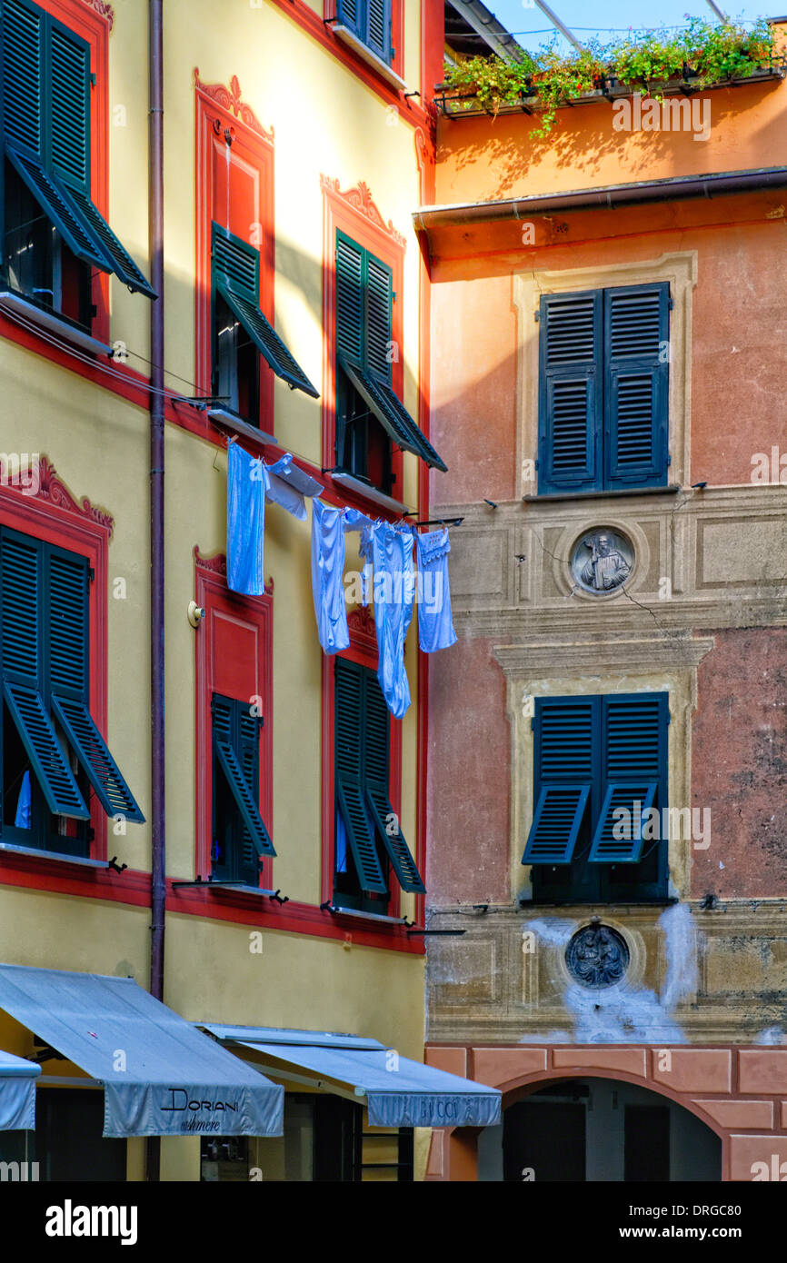 Close Up View of a House Facade with Shuttered Windows and Clothes Drying, Portofino, Liguria, Italy - Stock Image