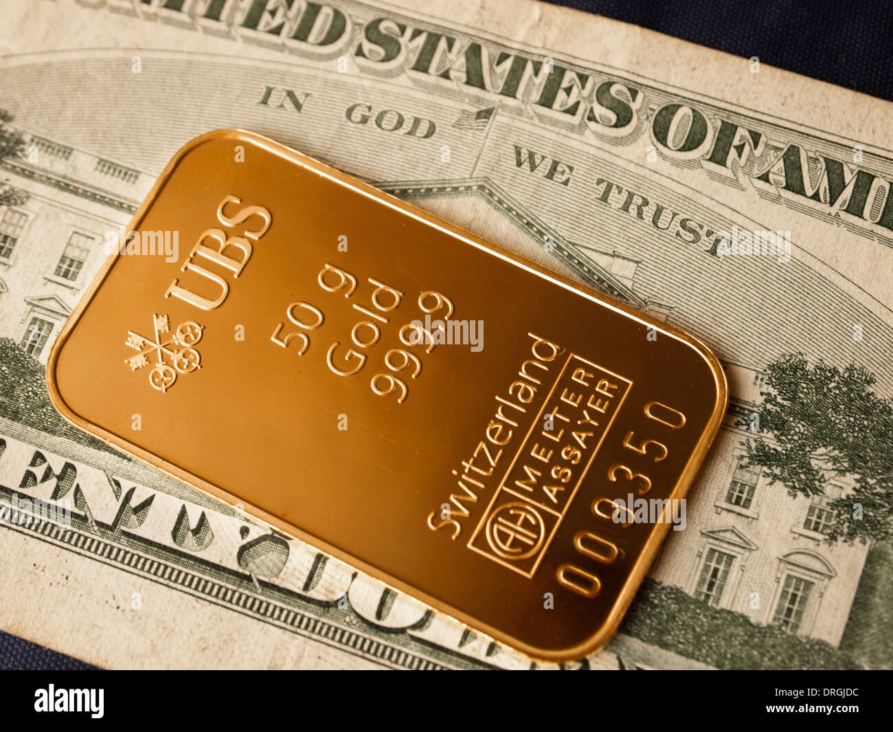 A 50g gold ingot issued by the Swiss bank UBSon  US dollar note - Stock Image