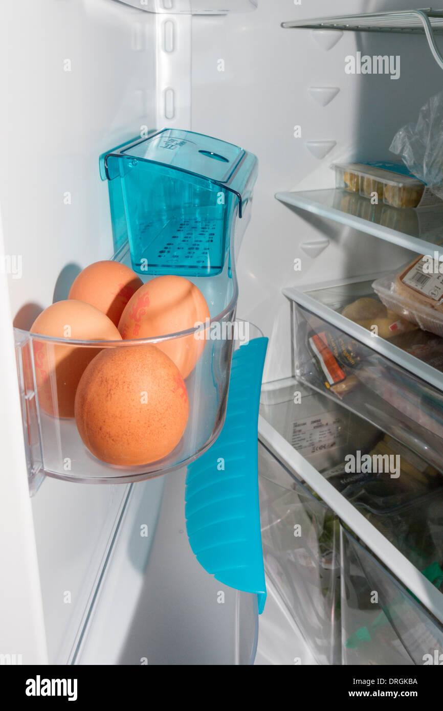 Eggs kept fresh/stored inside a fridge door - Stock Image