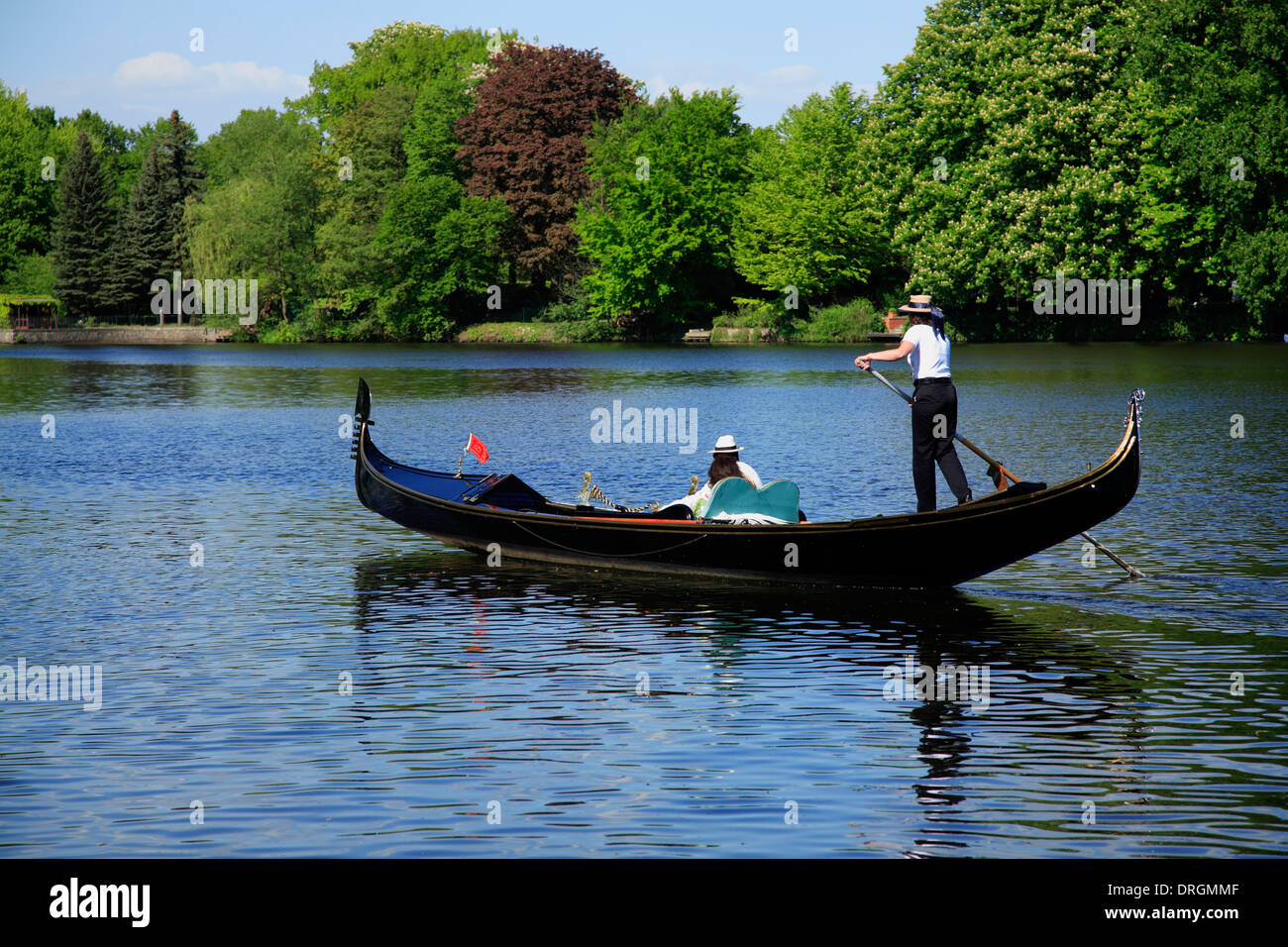 Female gondoliera on lake Alster, Hamburg, Germany, Europe Stock Photo
