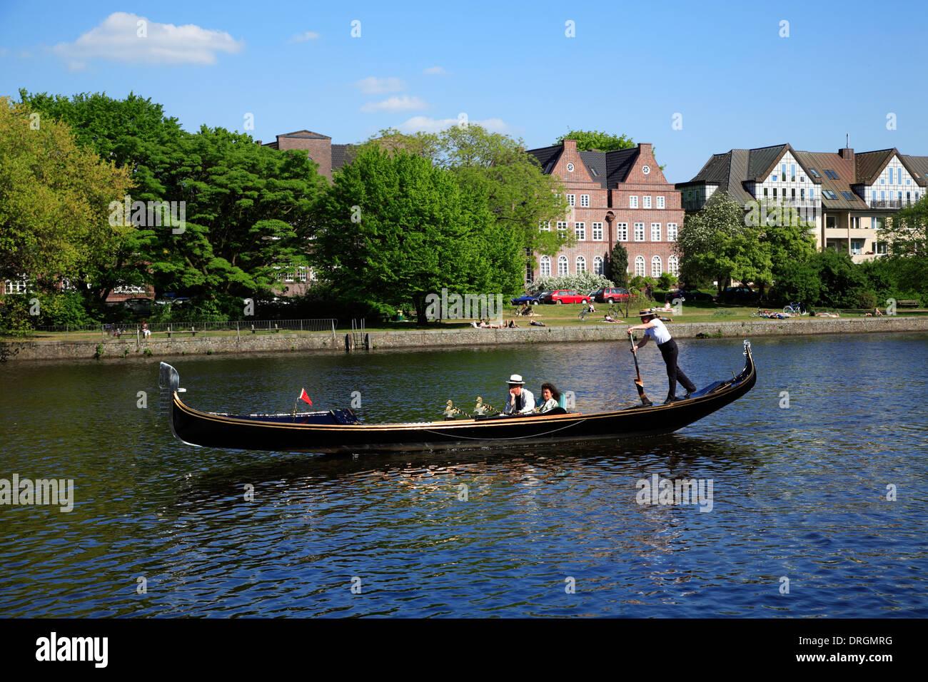 Female gondoliera on lake Alster, Hamburg, Germany, Europe - Stock Image
