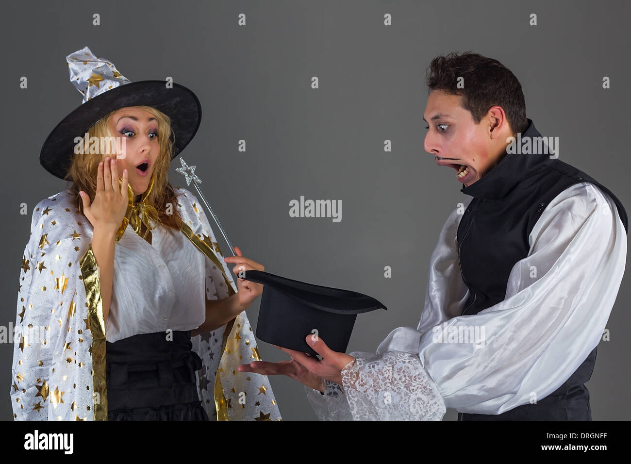 Magician man and fairy girl surprises of hat - Stock Image