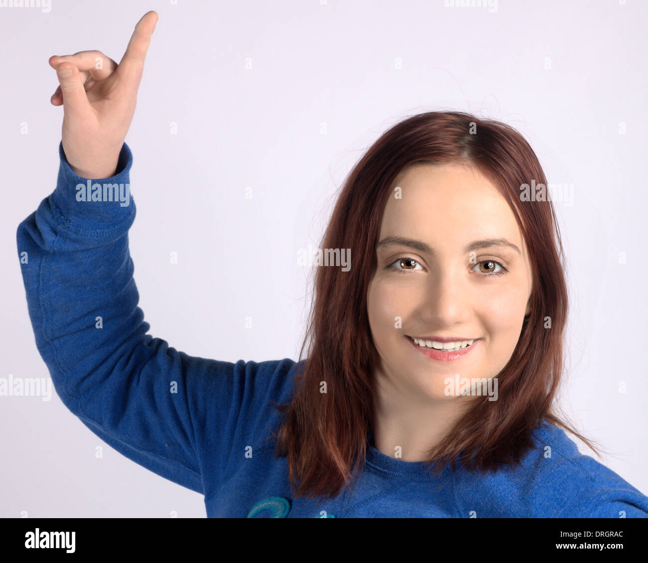 young girl pointing with finger - Stock Image