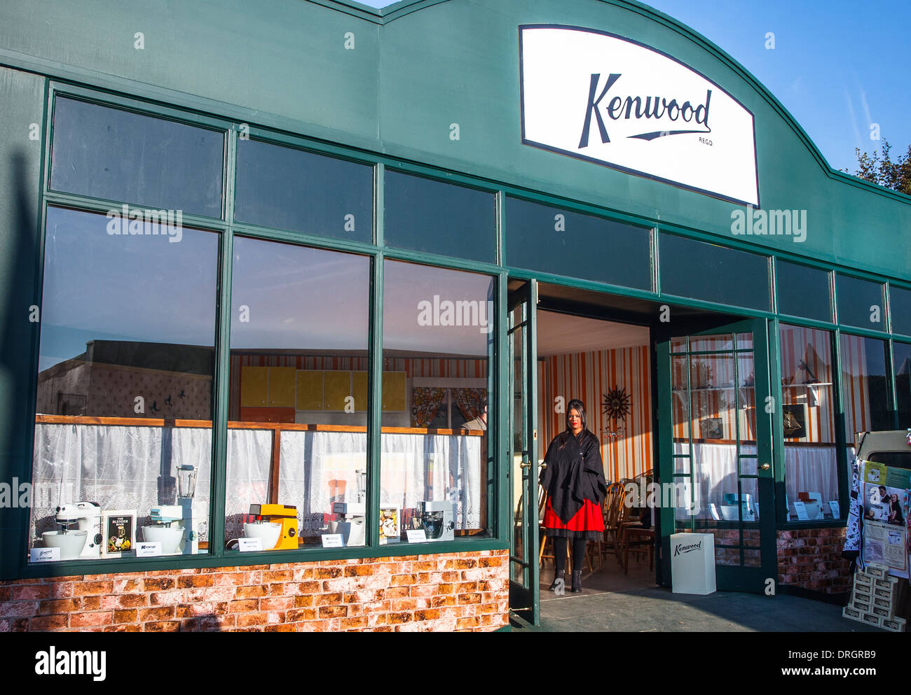 Woman standing in doorway of a Kenwood food mixer shop at the Goodwood Revival 2013, West Sussex, UK - Stock Image