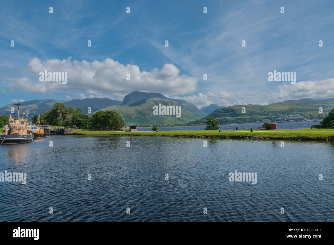 Boats in Caledonian Canal at Corpach nr Fort William Highland Scotland looking towards Ben Nevis Stock Photo