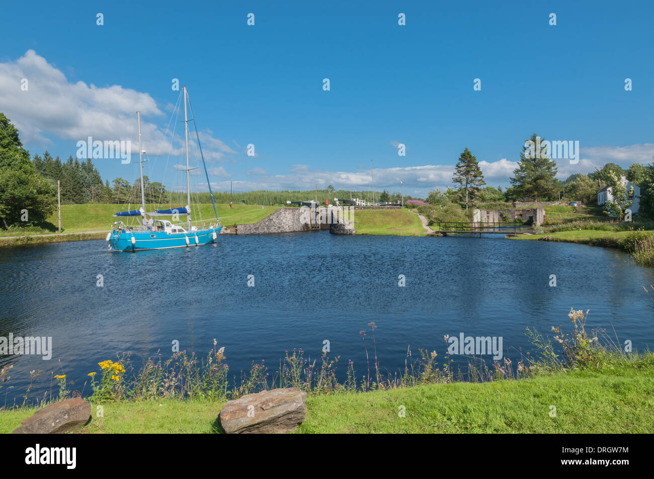 Yacht going along CrinanCanal at Dunardry Locks Argyll & Bute Scotland - Stock Image