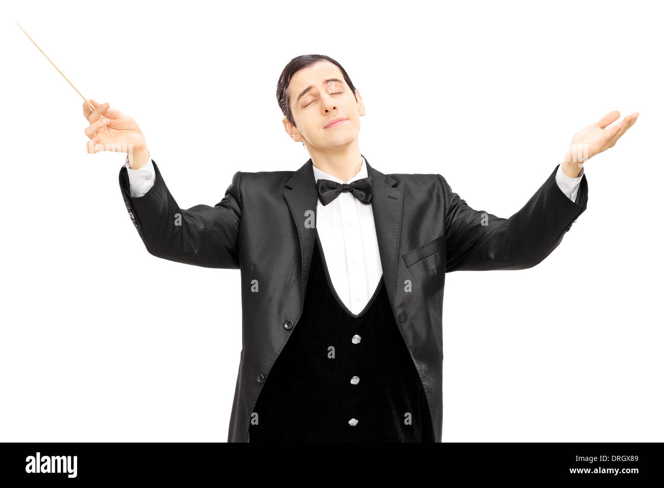 Male orchestra conductor directing with baton - Stock Image