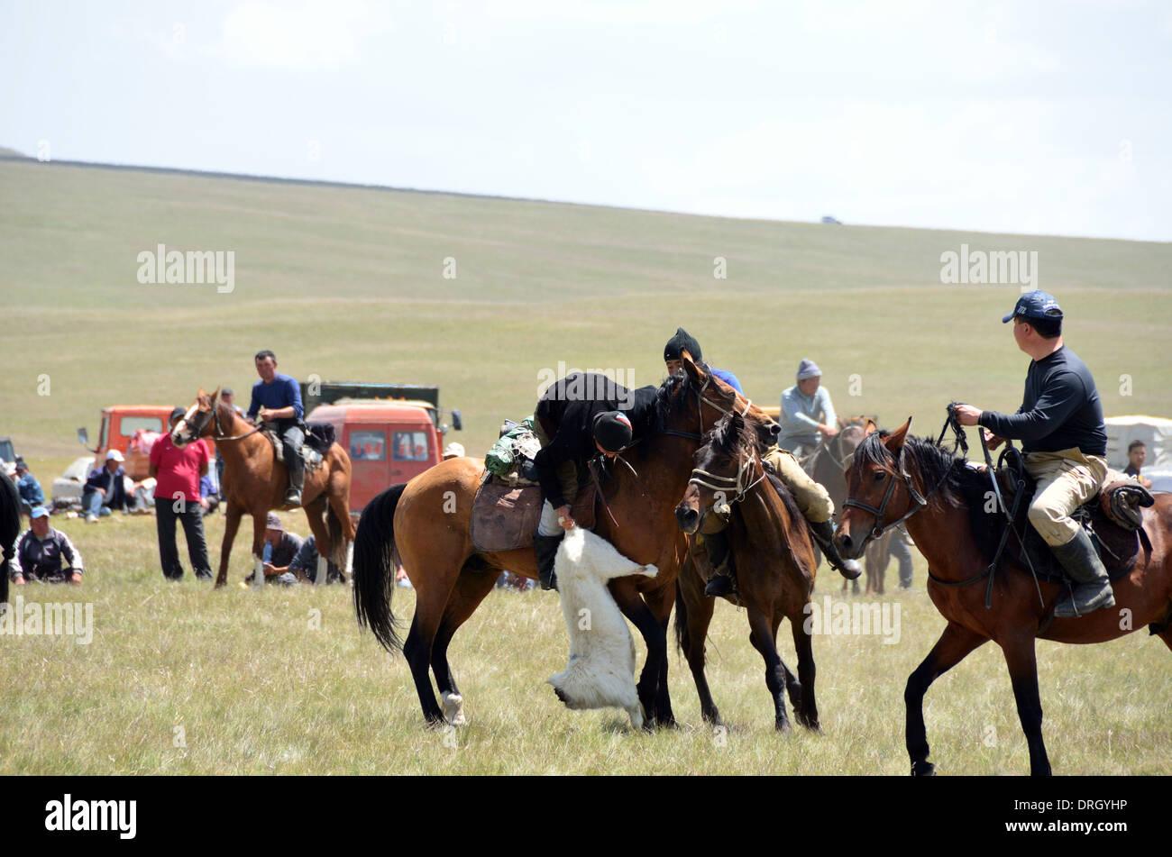 Buzkashi or Kokpar - a Central Asian sport - Stock Image