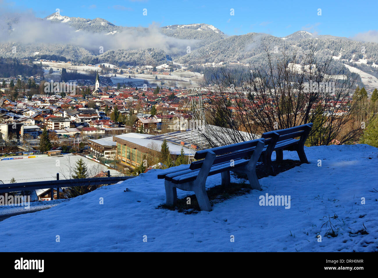 Above Oberstdorf in the Allgäu in winter with a snow fall  looking down upon the town - Stock Image