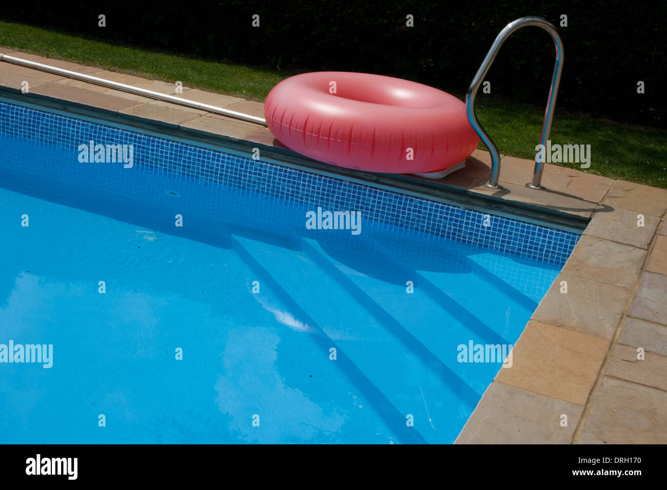 Red rubber ring at edge of swimming pool Stock Photo ...