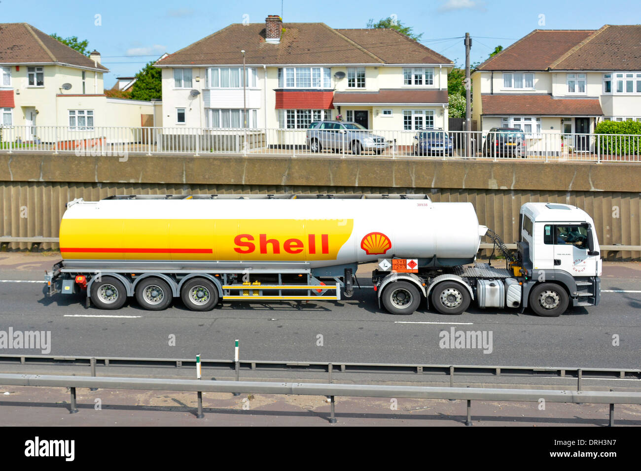 Houses close to A12 dual carriageway trunk road with heavy noisy hgv lorry traffic - Stock Image