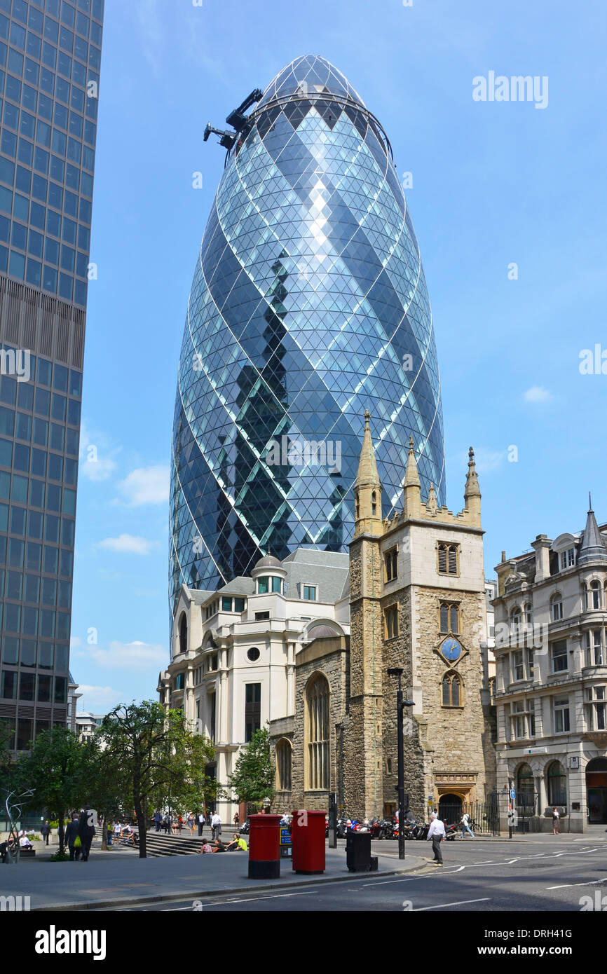 Gherkin office block and St Andrew Undershaft church tower - Stock Image