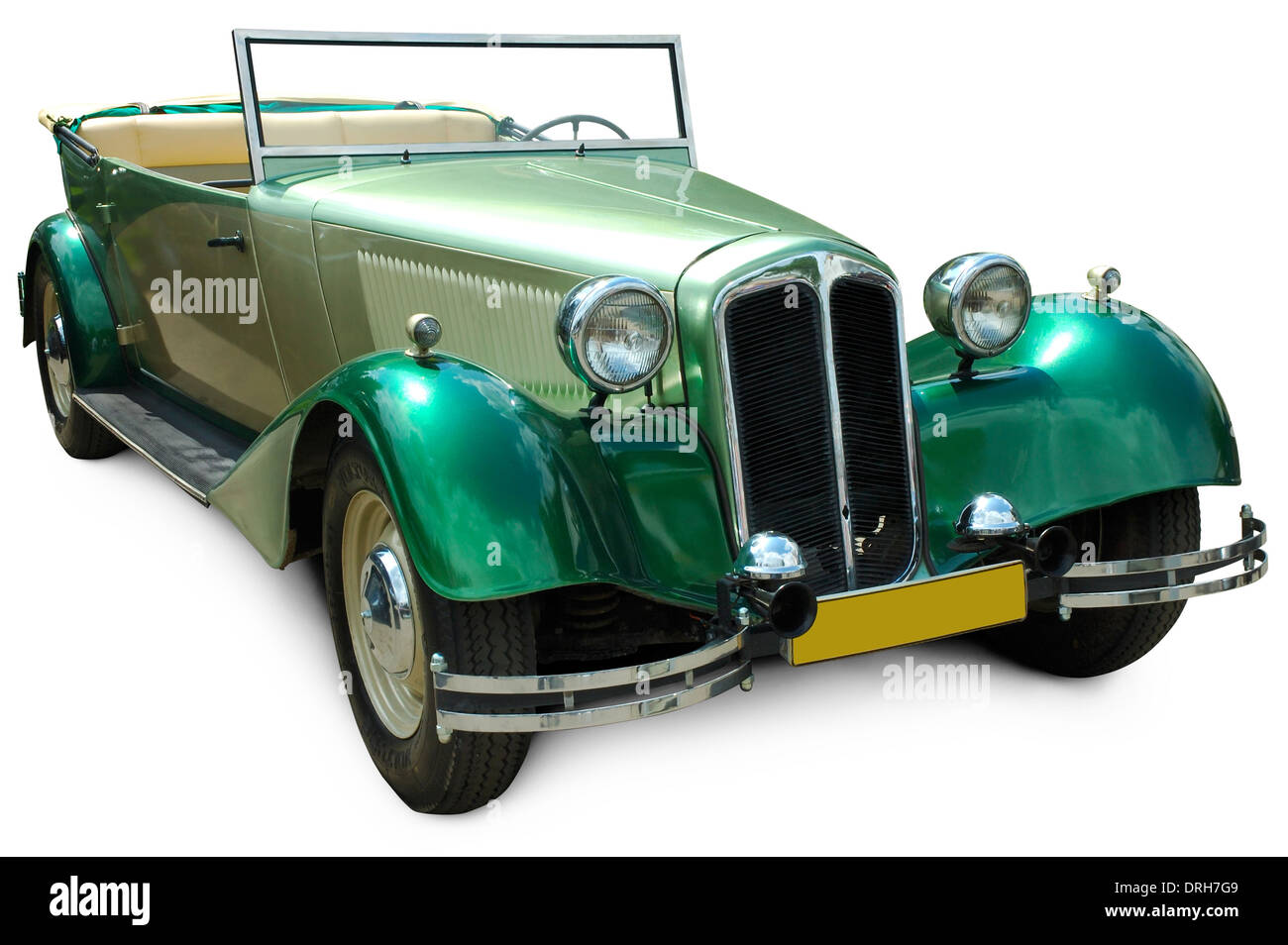 Classic green convertible vintage car isolated on white background with clipping path - Stock Image