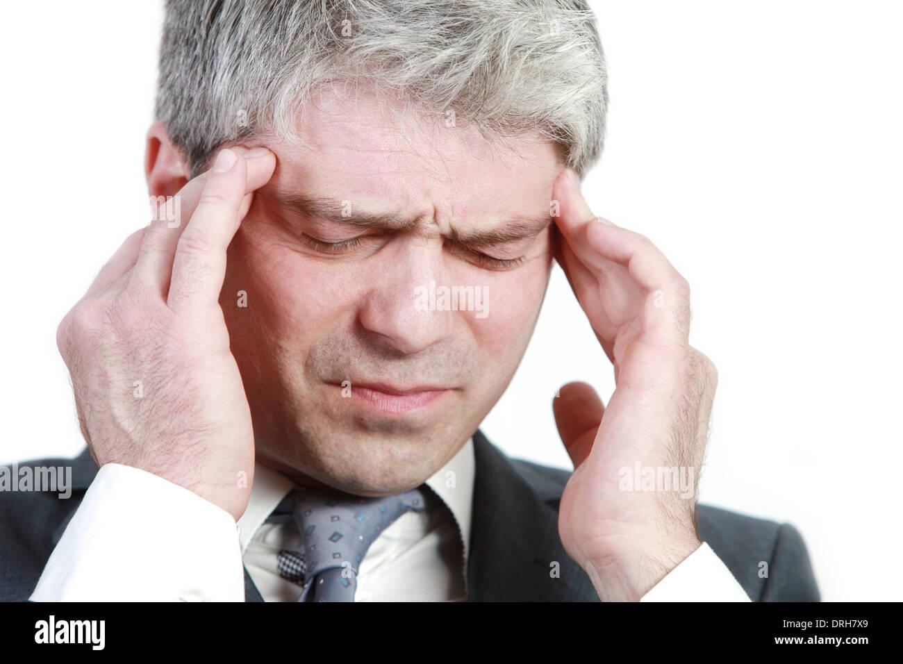 Businessman under pressure... having head ache... - Stock Image