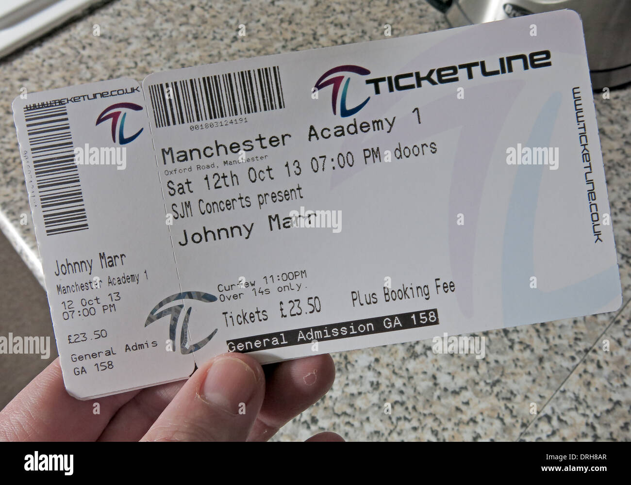 Person holding Johnny Marr Concert Ticket Manchester 2013 Stock Photo