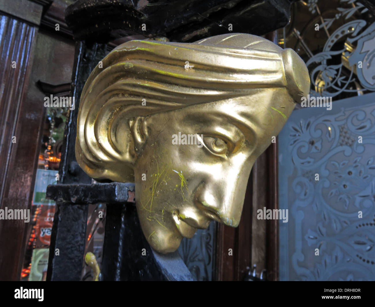 Gold face at entrance to the Philharmonic Dining Rooms pub in maritime Liverpool  England UK - Stock Image