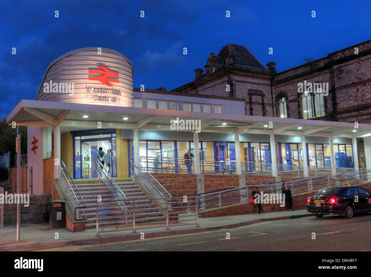 Warrington Central station at dusk, Cheshire, England, UK - Stock Image