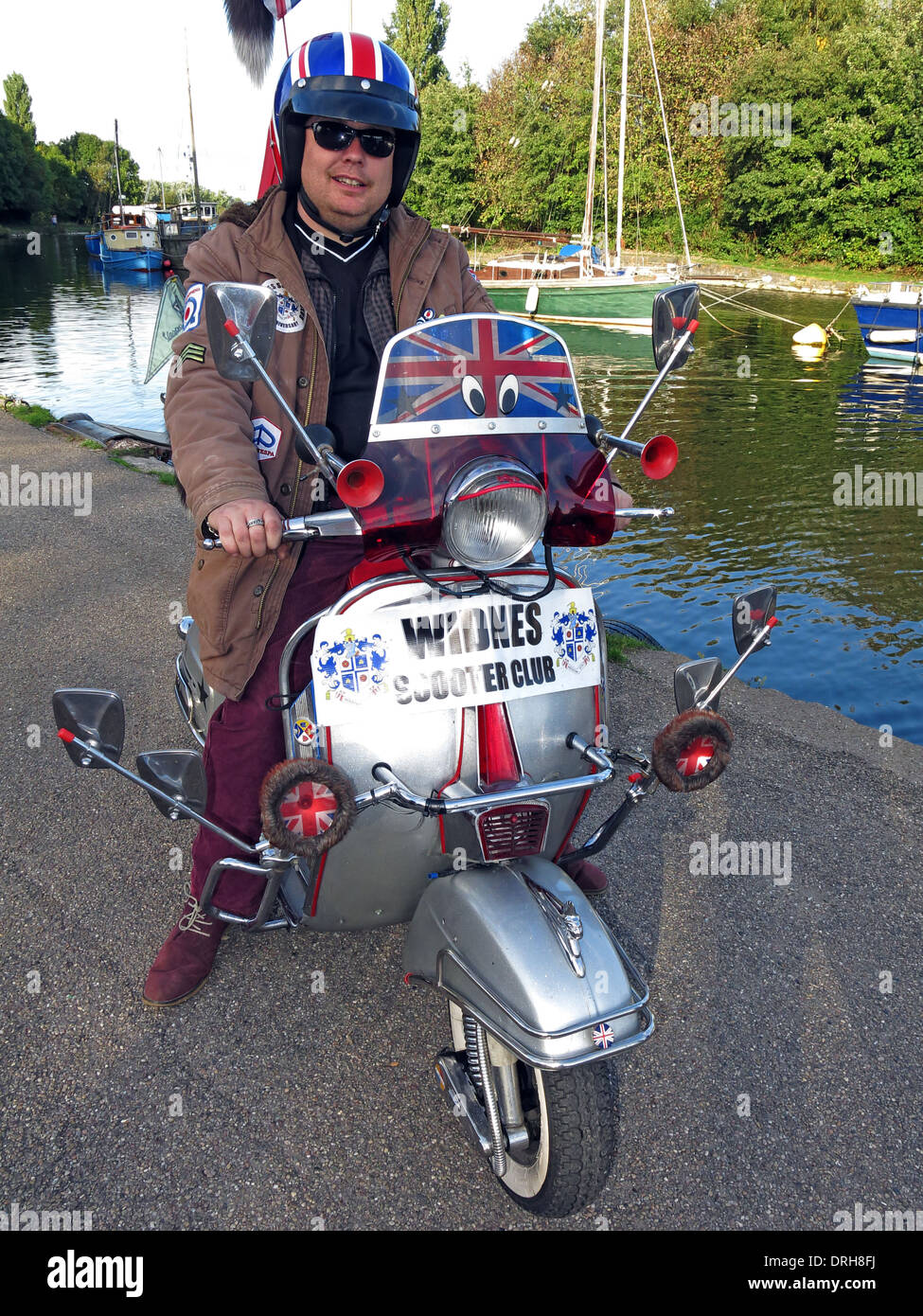 Rider from Widnes Scooter Club Halton North West England UK - Stock Image