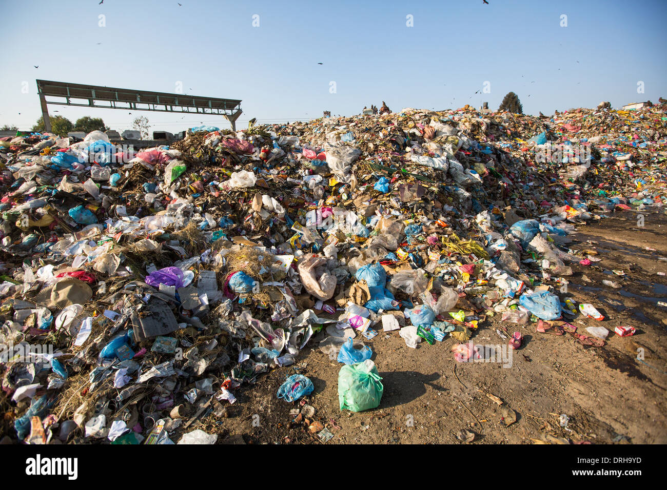 Food and pile of domestic garbage in landfill. - Stock Image